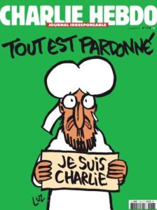 Tout est pardonné - Alles is vergeven. Op de afbeelding is Mohammed te zien die een bordje vasthoudt met ' Je suis Charlie' erop.